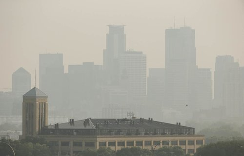 Smoke obscures the skyline of downtown Minneapolis, July 6, 2015. Minneapolis Star Tribune.