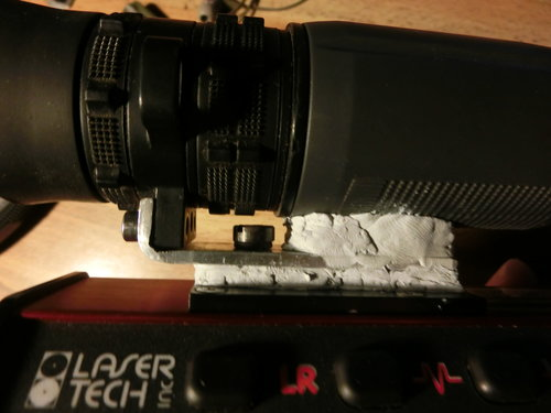 second application of Epoxy plastic putty. Filling in gaps under the mount and add more support material under scope body